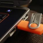 Folding USB Drive in Orange, inserted