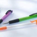 Pens placed horizontally on a blue background