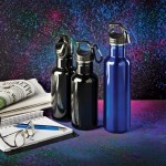 Black and Blue Water Bottles next to the Newspaper & Notepad