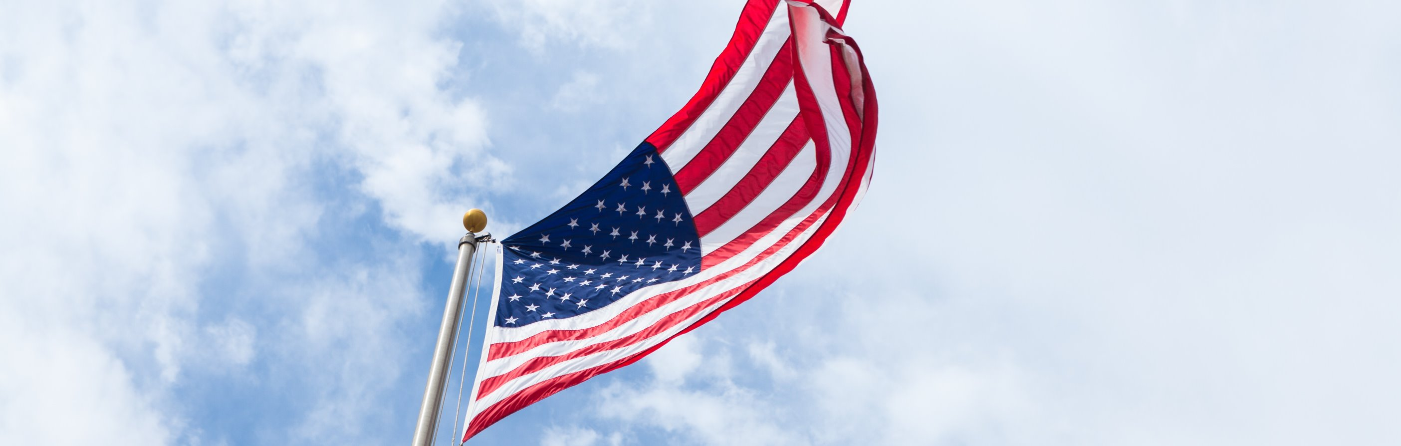 US flag against sky